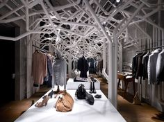 What a clever use of pipes!  Contemporary Retail Clothing Store Design