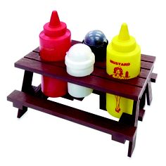 This decorative condiment set is designed as a miniature picnic table for displaying bottles of ketchup, mustard, salt and pepper. #bbq #barbecue #picnic