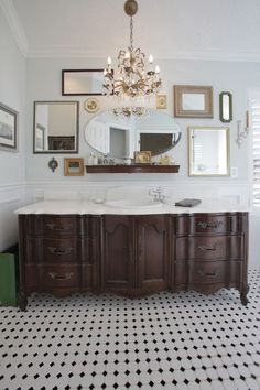 Love using an old dresser for a vanity. and the collection of mirrors is a great idea!  Needs two sinks.