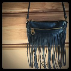 "Fringe Crossbody Purse Small black fringe crossbody bag. Pre-Owned, look of wear on the inside. Always got compliments. I moved on to a bigger purse. Gold hardware. About 10"" length, 7"" height. Strap drop about 2'3"". Bags Crossbody Bags"