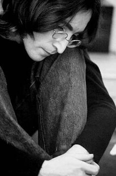 John Lennon -- this picture of John has me imagining curling up with him on a rainy afternoon while he whispers song lyrics as he creates them. Reflective and sensual. I like it!