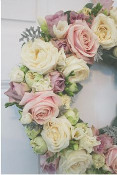 Floral wreath beautiful roses. We would not have as many roses, there would be hydrangea mixed in...