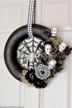 This dark wreath is a spooky winner. Add glitter and place mini skeleton faces around the border for a sweet and scary combination. Get the tutorial at A Pumpkin & A Princess.