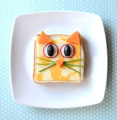 A sandwich decorated to look like a cat.