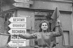 Eugene Khaldey - war photographer another famous photograph - a snapshot of the corporal of the 87th separate road maintenance battalion Mary Shalneva that regulated the movement of military equipment close to the Reichstag in Berlin.