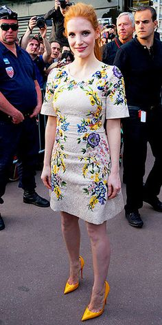 JESSICA CHASTAIN Following her major wind moment on the Foxcatcher red carpet, the actress opts for a beige floral-print Dolce & Gabbana dress with coordinating yellow Christian Louboutin pumps while making an appearance at the Le Grand Journal studios.