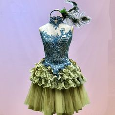 Peacock tutu To follow more boards dedicated to dance photography, costuming, pas de deux, little ballerinas, quotes, pointe shoes, makeup and ballet feet follow me www.pinterest.com/carjhb. I also direct the Mogale Youth Ballet and if you'd like to be patron of our company and keep art alive in Africa, head over to www.facebook.com/mogaleballet like us and send me a message!