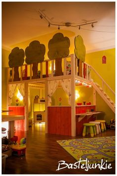 DIY children's bed and kitchen underneath. Amazing!!!