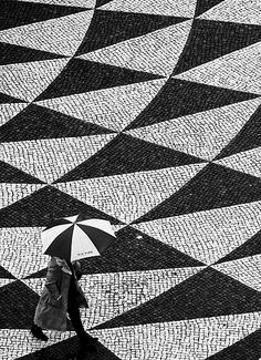 Umbrella and Portuguese Traditional Pavement by Miguel Lopes. #Lisbon #Lisbon_rain