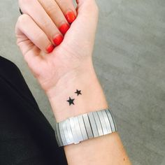 Cute and small wrist star tattoo