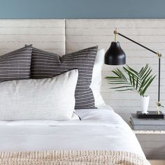 This faded black and cream pillow has a beautiful textured stripe and hand-loomed appearance, elevating an otherwise basic stripe into a thing of beauty.