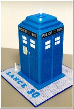 TARDIS by Melissa Makes Cakes. How did she get the blue just right? It's amazing!