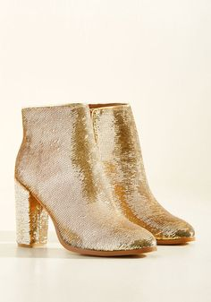 What's the advantage to rockin' these stellar gold booties? Let's be honest, there's no disadvantage! This ModCloth-exclusive, faux-leather pair, touting sturdy block heels and decorated from ankle to toe in sparkling sequins, are your new number one choice every time you're headed out for the night.