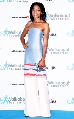 Naomie Harris wears a strapless dress by Tory Burchwith a Jimmy Choo clutch