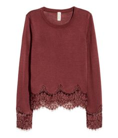 Dark brick red. Fine-knit sweater in a soft viscose blend with wide lace trim at cuffs and hem.