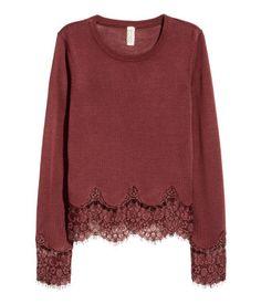 Dark brick red. Fine-knit sweater in a soft viscose blend with wide lace trim at cuffs and hem.