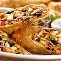 Baked eggrolls with a Southwest twist, chicken, onion, beans, corn, spinach, and jack cheese are rolled in tortillas and served with salsa or your favorite sauce for dipping.