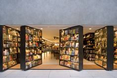 """Livraria da Vila bookstore in Brazil features creative doors made out of bookshelves.""   You could make a wall out of bookshelves that opens onto a patio--if the climate were right!"