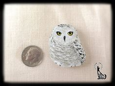 Snow owl painted on sea glass by AkiesStoneArtGallery on Etsy