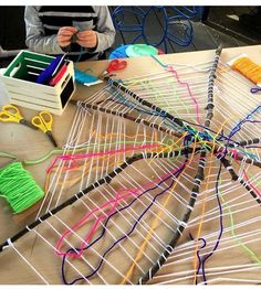 Cobweb weaving - sticks, string and wool.