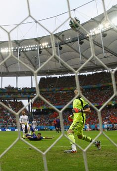 The Flying Dutchman - Iker Casillas of Spain watches as a header from Robin van Persie of the Netherlands goes over his head for a goal in the first half during the 2014 FIFA World Cup Brazil Group B match between Spain and Netherlands at Arena Fonte Nova on June 13, 2014 in Salvador, Brazil. (Dean Mouhtaropoulos/Getty Images)