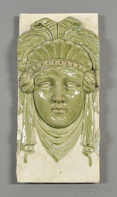 Zsolnay Architectural Portrait Tile  Art pottery  Hungary, c. 1885  Majolica glaze pyrogranite tile depicting a female with head dress in relief in celery green and cream-colored glazes, impressed form no. 4079, Zsolnay and five steeple mark, chip, ht. 17, wd. 8 in.