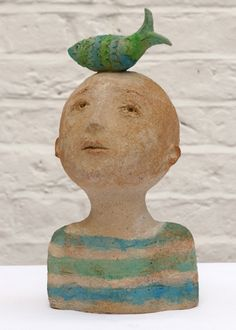Love this ceramic sculpture of a boy with a fish on his head!   by Francis Baruch