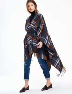 Boden Helena Cape: http://www.stylemepretty.com/living/2015/11/14/what-to-wear-to-thanksgiving-dinner/