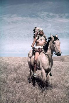 LATE 1940's: A Native American chief poses for a photo on his horse during the Inter-Tribal Indian Ceremonial circa late 1940's in Gallup, New Mexico.