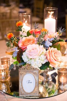 HEPATICA wedding florals (roses, safflower, eryngium thistle, hydrangea, in coral, blue and white with gold accents) – photo: Elizabeth Craig Photography