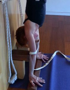 Adho Mukha Vrksasana, fingers facing backward variant. Iyengar Yoga.