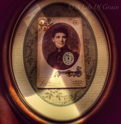 One of my frames I did as a gift. Glued old watch parts to a Victorian photo, then backed it on vintage 1930s material and placed it in an old picture frame.