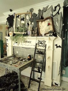 Rats, bats, crows, and a table cabinet full of curiosities—we hardly know where to look first! This creepily curated look is sure to captivate your guests and spark conversations.