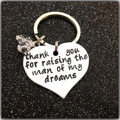 Hand Stamped KeyChain thank you for raising the man of my dreams Wedding Gift Mother In Law Mother Of the Groom key chain ring. $19.95, via Etsy.