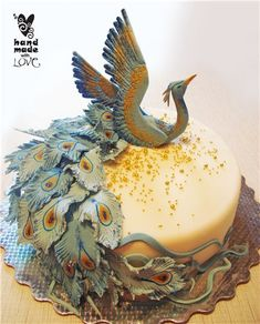 In Russian. Phoenix cake. Would be amazing in red, gold and purple.