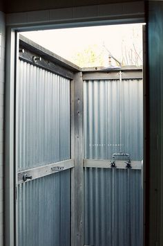 outdoor shower, corrugated metal, photo by @Bonnie S. Tsang