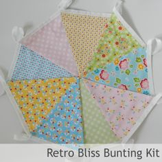 Bunting Kit - Retro Bliss (Limited Edition) - all you need to make 3 mtrs of fab bunting in solid colours inspired by all things girly!  Triangles, specialist bunting tape, full instructions and a fab drawstring bunting bag to store you homemade bunting i