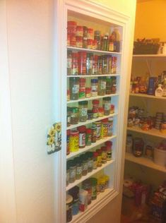 Ohhh, look at this really shallow shelf built into the pantry. Perfect for little bottles of spices. {featured on Home Storage Solutions 101}