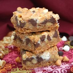 Baked Bars with a coconut graham cracker crust topped with walnuts, two types of chocolate and butterscotch chips.