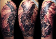 If I was a dude I would totally get this tattoo. I love the symbolism in this picture.- St Michael the arch angel defeating satan.
