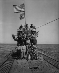 """Salvage party in front of the conning tower of """"JUNIOR"""", (U-505)."""