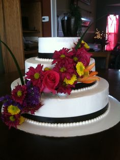 Practice cake (my husband thought it was yummy!).  White/white icing,  pearl/white fondant beading, black silk ribbon and real flowers.