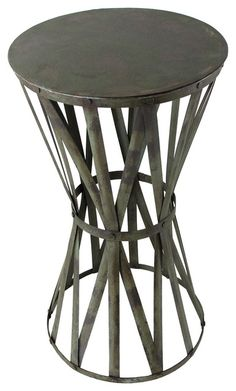 "Jaswant Industrial Rustic Verdi Green Tall Drum Iron Side Table $207  Drumroll, please! Crosshatched metal bands are riveted to the top and bottom and cinched together to create this tapered drum-shaped side table. Finished with antique paint for an exceptional look, this unique iron table makes a bang-on by-the-door accent table!    Kathy Kuo Home   Width 15.0""  Depth 15.0""  Height 28.0""  Cast Iron"