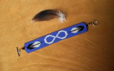Metis flag infinity bracelet. Apprx.6 1/2 long from toggle ends. Be sure to measure your wrist or the wrist of the person it is meant for. . If you like this bracelet but need it in a larger or smaller size, I will make it for you. Just be sure to specify when you order, by Simple Bracelets, Bead Loom Bracelets, Bracelet Crafts, Woven Bracelets, Native Beading Patterns, Seed Bead Patterns, Beaded Jewelry Patterns, Seed Bead Jewelry, Seed Bead Earrings