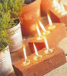 Simple, inexpensive and cute, tea lights in basic bricks - from rustic to industrial to chic depending on the treatment used on the bricks, if any.