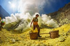 A miner collects sulfur in an Indonesian crater in this National Geographic Your Shot Photo of the Day.