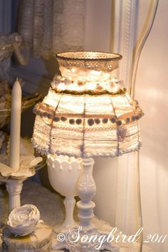 Lace, ribbons, threads give a simple lamp shade the Oh la la! factor.