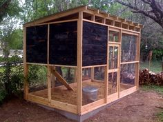 Medium chicken coop - modern design with ancient techniques - charred cedar to keep out insects and mildew #DIYchickencoopplans #ChickenCoopPlans