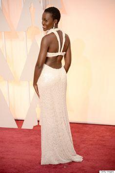Lupita Nyong'o on the red carpet; Oscar Awards 2015. Pearl dress by Calvin Kline.