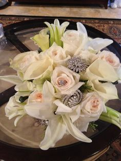 Broaches in bridal bouquet